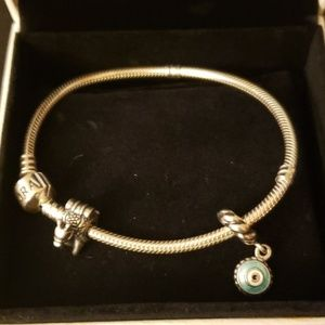 Pandora bracelet with two charms.